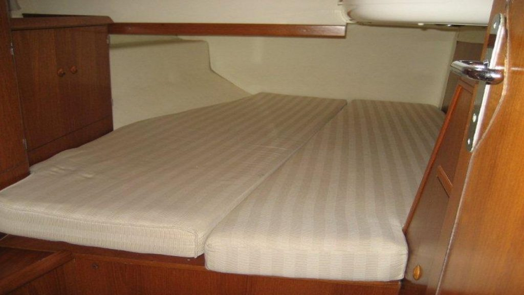 bed without sheets on boat