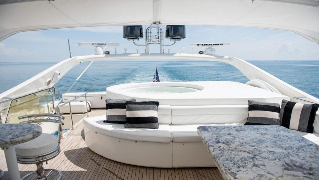 Ferretti 00Z outdoor living area of yacht in the water