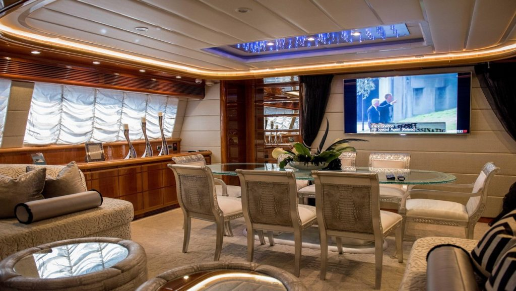 Ferretti 00Z indoor dining area with TV