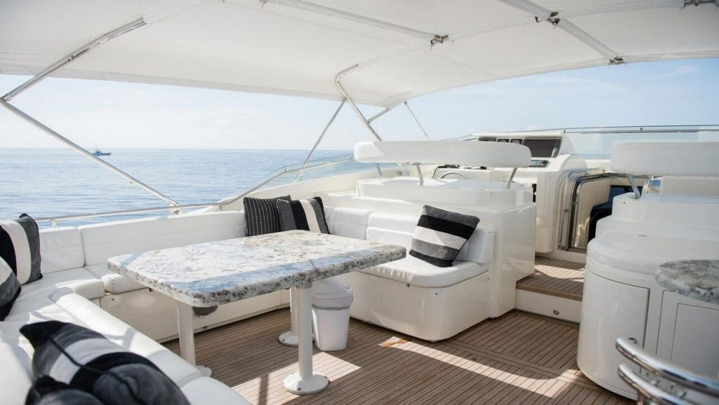 Ferretti 00Z outdoor living area of boat in the water