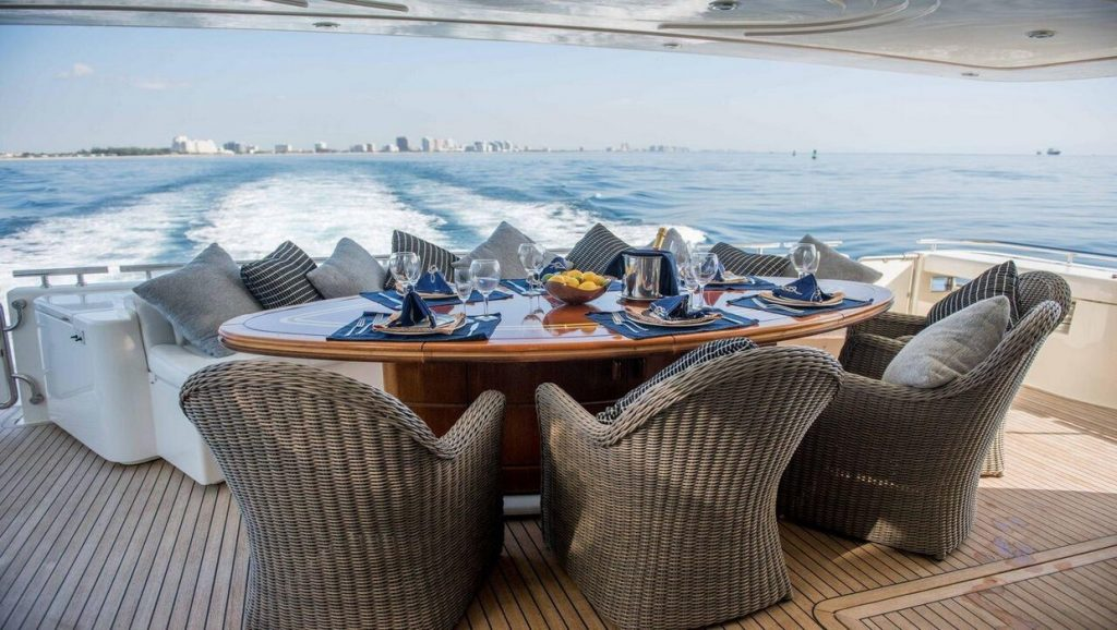 Ferretti 00Z outdoor dining area with waves in the back