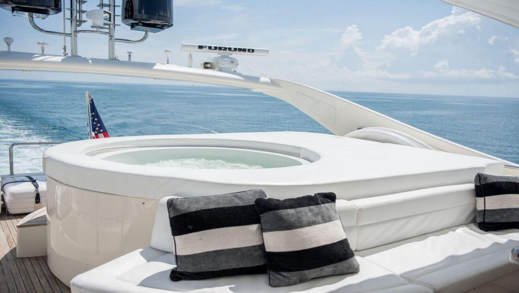 Ferretti 00Z hot tub on top deck with view of city